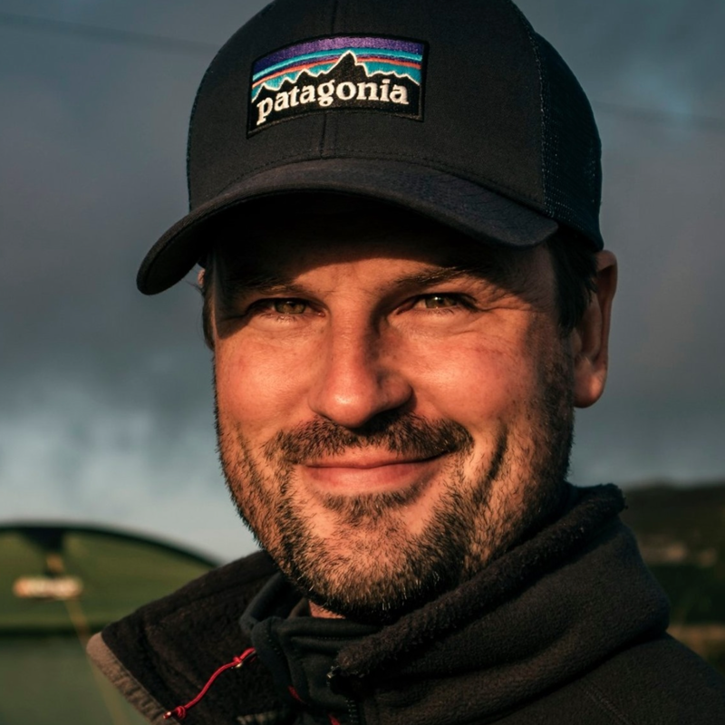 Portrait head shot photo of Edward Felton wearing a patagonia baseball cap