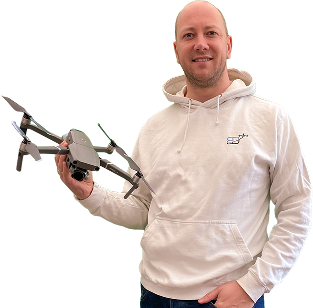 "body shot photo of Philippe Francken wearing a Bristol Drones hoody and holding a ""DJI"" ""Mavic 2 Pro"" drone"