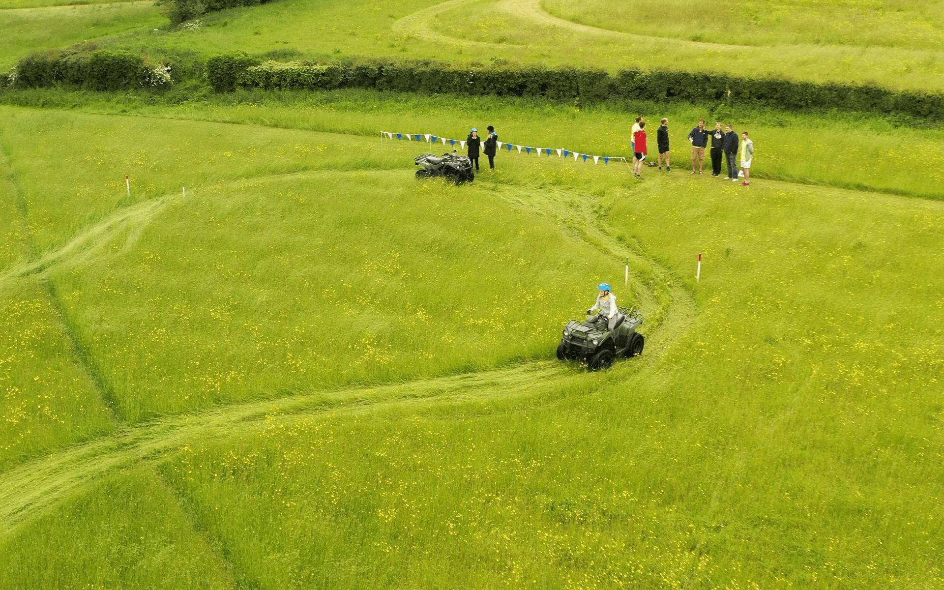 """DJI Mavic 2 Pro"" aerial drone photo of ""Hydrock"" employee on a quadbike in a field at corporate event in almondsbury bristol"