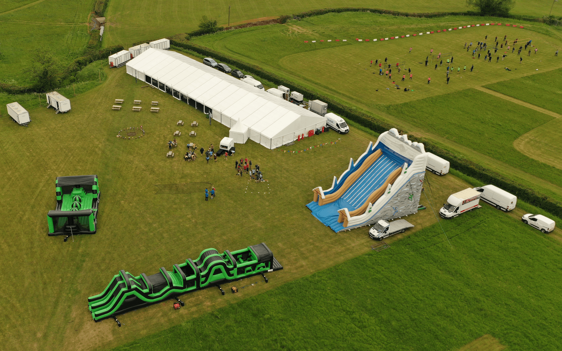"""Mavic 2 Pro"" aerial drone photo of inflatable obstacle course in field at ""Hydrock"" corporate event in almondsbury bristol"